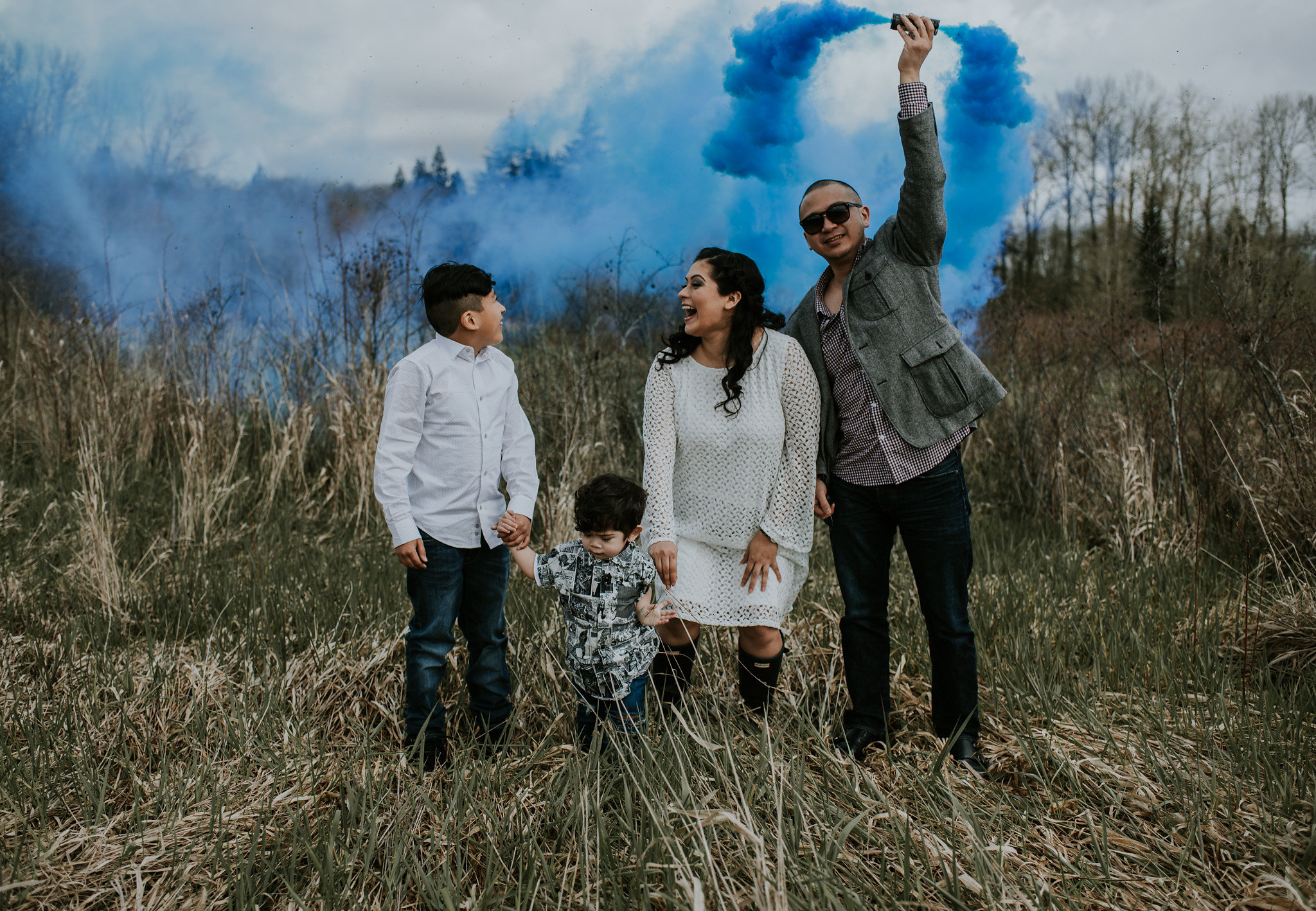 Unique Gender Reveal, Smoke Bomb Gender Reveal, It's a Boy Gender Reveal, White Dress with Bell Sleeves, Floral Crown, Blue and White Floral Crown, Smoke Bomb Reveal, Gender Reveal Ideas, Baby Shower Outfit